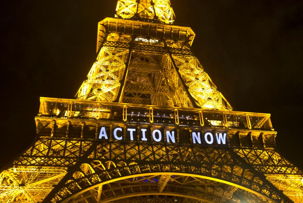 "The Eiffel Tower lights up with the slogan""Action Now""referring to the COP21, United Nations Climate Change Conference in Paris, Sunday, Dec. 6, 2015. Negotiators adopted a draft climate agreement Saturday that was cluttered with brackets and competing options, leaving ministers with the job of untangling key sticking points in what is envisioned to become a lasting, universal pact to fight global warming. (AP Photo/Michel Euler)"
